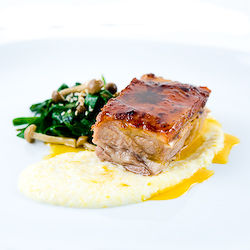 Pork Belly confit with tangerine-sesame emulsion, grits & chinese chives
