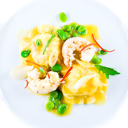 "Langoustine Ravioli with Citrus-Coconut Sauce, Thai ""Bird's Eye"" Chili & Fava Beans"