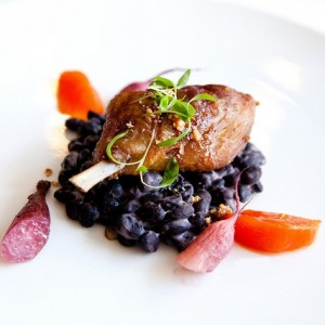 Confit duck leg with fuyu persimmon, red wine braised radishes, black beans, and sesame from Blackbird in Chicago