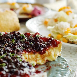 Wild cranberry sauce topped Brie