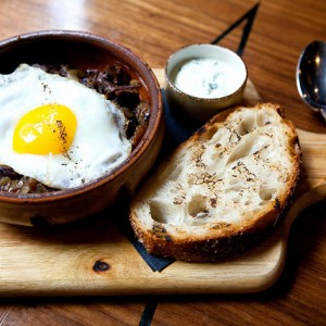 Braised short ribs beef hash with sunny side egg at Balaboosta