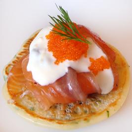Herbed Blinis with Gravlax, Masago & Lemon-Caper Crème Fraîche