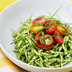 Trofie with arugula pesto and flash-sautéed cherry tomatoes with garlic scapes