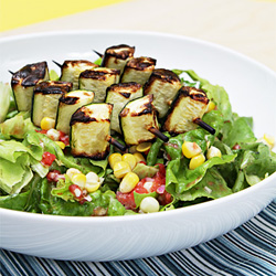 Boston lettuce with corn, fresh tomato vinaigrette and grilled zucchini skewers