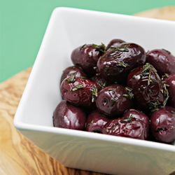 Pan-fried olives with rosemary