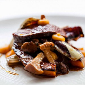 ANDY MCLEISH\' S ROAST LOIN OF VENISON WITH BUTTERNUT SQUASH, GIROLLES AND ROAST TREVISO.